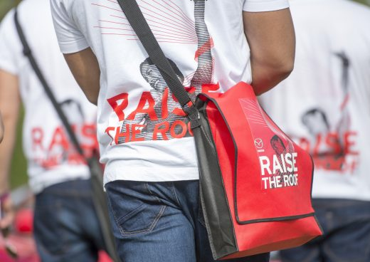 Raise the Roof branded seen of staff bags and t-shirts during the Moving Motorshow on Day 1 of Goodwood Festival of Speed at Goodwood House on June 25, 2015. Photo by Christopher Lee/Drew Gibson Photography